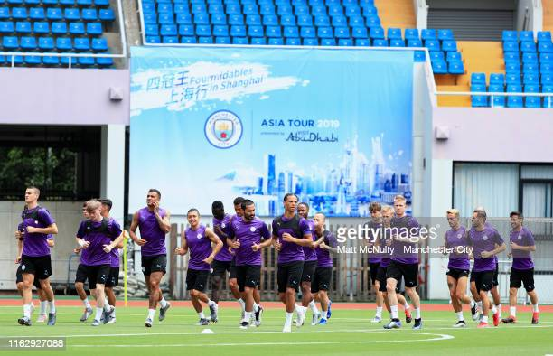 Manchester City players warm up during the training session at Yuanshen Stadium on July 19 2019 in Shanghai China