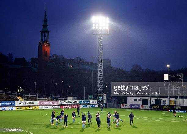 Manchester City players warm up during the UEFA Women's Champions League Round of 32 First Leg at Valhalla IP Stadium on December 09, 2020 in...