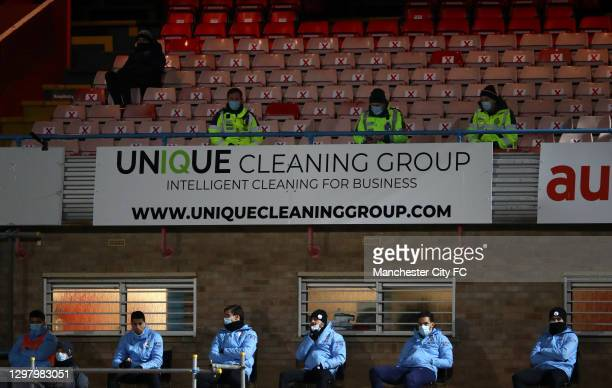 Manchester City players watch on from the bench during The Emirates FA Cup Fourth Round match between Cheltenham Town and Manchester City at Jonny...