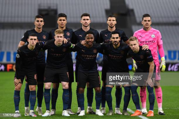 Manchester City pose for a team photo during the UEFA Champions League Group C stage match between Olympique de Marseille and Manchester City at...