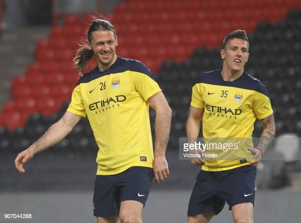 Manchester City Post Season Tour Day Three Abu Dhabi Manchester City's Martin Demichelis and Stevan Jovetic at open training at Al Jazira Stadium in...
