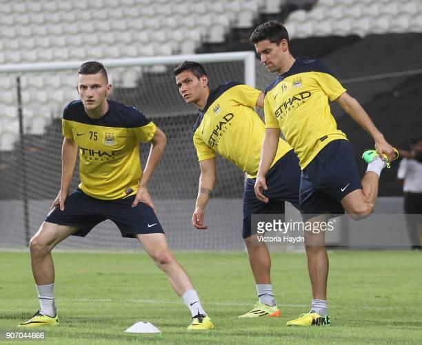 Manchester City Post Season Tour Day Three Abu Dhabi Manchester City's Sinan Bytyqi Marcos Lopes and Jesus Navas at open training at Al Jazira...