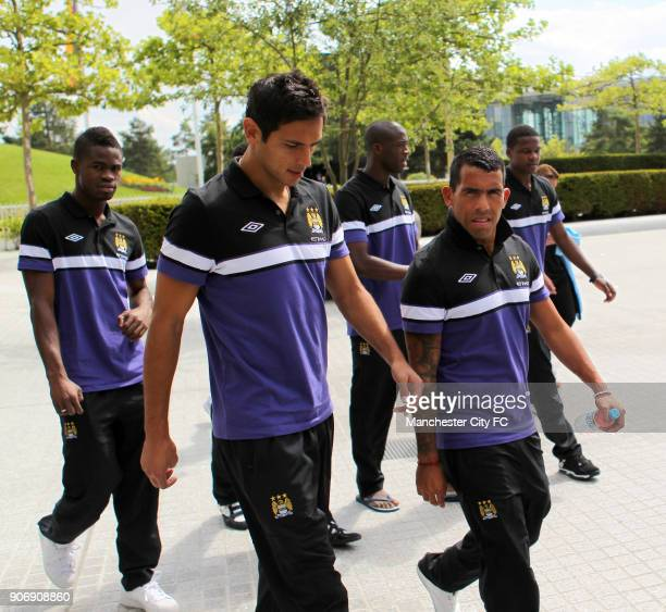 Manchester City Pre Season Tour Germany Manchester City's Abdul Razak Roque Santa Cruz and Carlos Tevez take part in a squad walk in Wolfsburg