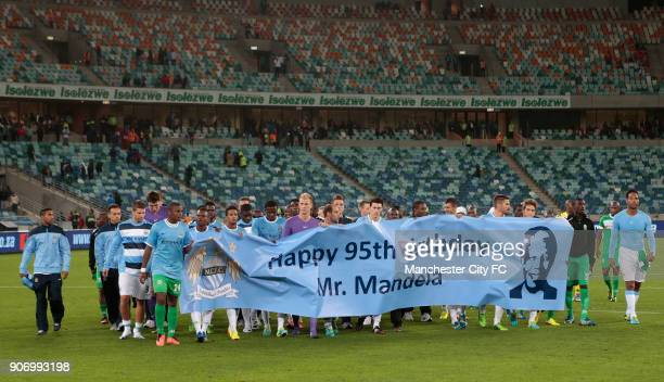 Manchester City Pre Season Tour Nelson Mandela Football Invitational AmaZulu v Manchester City Moses Mabhida Stadium Manchester City players hold a...