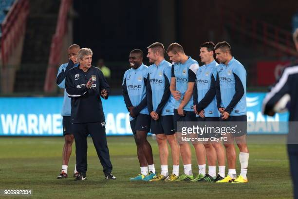 Manchester City PreSeason Tour South Africa Training Session Loftus Stadium Manchester City manager Manuel Pellegrini speaks with Micah Richards Javi...
