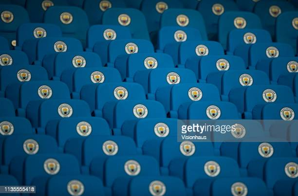 Manchester City seats showing the club crest before the UEFA Champions League Round of 16 Second Leg match between Manchester City v FC Schalke 04 at...