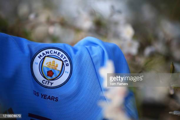 Manchester City shirt sita amongst blossom at Etihad Stadium during the coronavirus pandemic on March 24 2020 in Manchester England