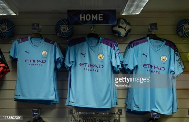 Manchester City shirts hang in the club shop before the UEFA Champions League group C match between Manchester City and Dinamo Zagreb at Etihad...