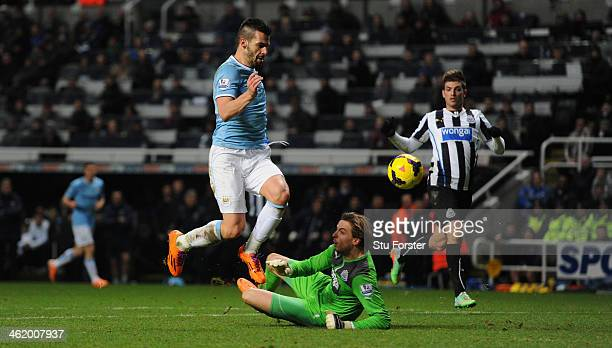 Manchester City striker Alvaro Negredo rounds Tim Krul before tapping into an empty net to score the second goal during the Barclays Premier League...