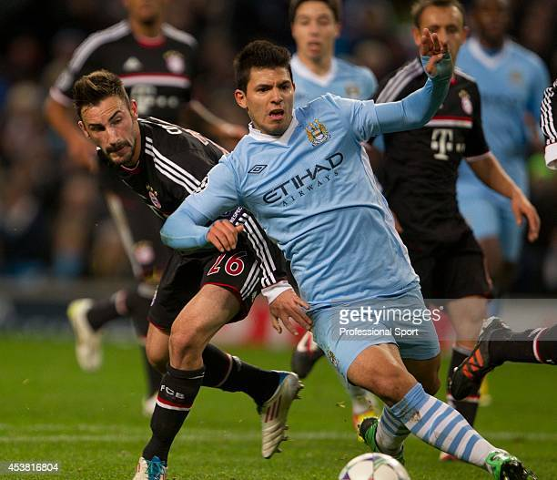 Manchester City striker Sergio Aguero gets away from Bayern Muenchen defender Diego Contento during the UEFA Champions League Group A match between...