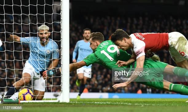Manchester City striker Sergio Aguero looks on after scoring his hat trick goal despite the efforts of Arsenal goalkeeper Bernd Leno and Laurent...