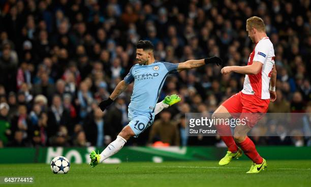 Manchester City striker Sergio Aguero scores the second City goal during the UEFA Champions League Round of 16 first leg match between Manchester...