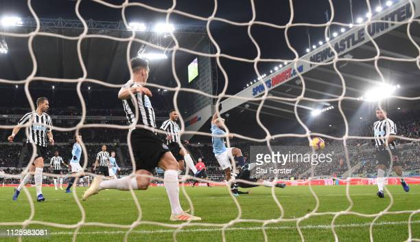 Manchester City striker Sergio Aguero shoots to score the opening goal during the Premier League match between Newcastle United and Manchester City...