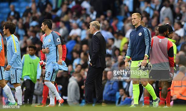 Manchester City sub Joe Hart looks on after the Premier League match between Manchester City and Sunderland at Etihad Stadium on August 13 2016 in...