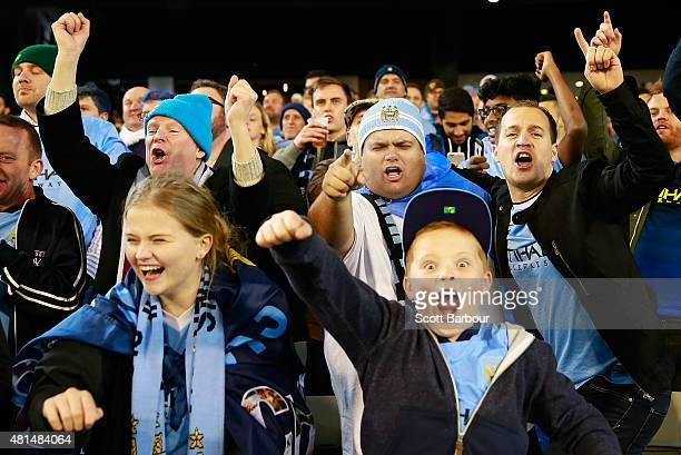Manchester City supporters celebrate as their team scores a goal during the International Champions Cup match between Manchester City and AS Roma at...