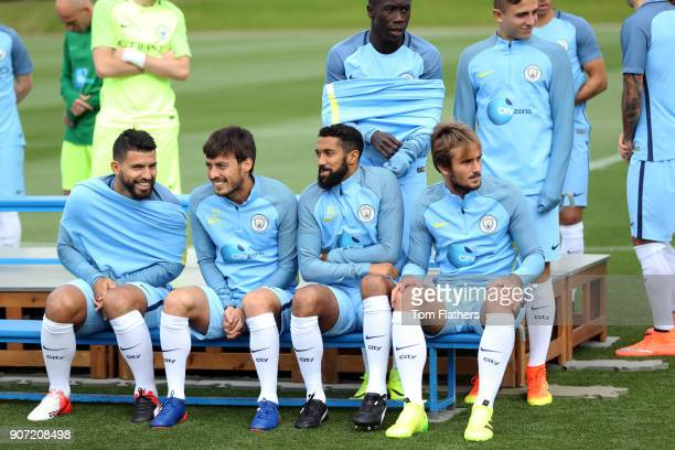 Manchester City Team Group Photo Behind The Scenes Manchester Manchester City's Sergio Aguero David Silva Gael Clichy and Alex Garcia during a...