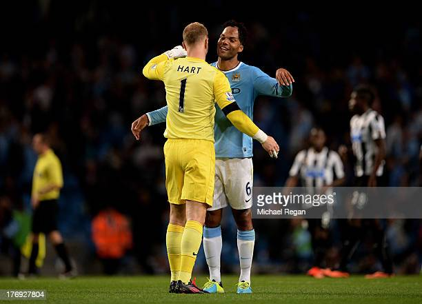 Manchester City teammates Joe Hart and Joleon Lescott celebrate their team's 40 victory during the Barclays Premier League match between Manchester...