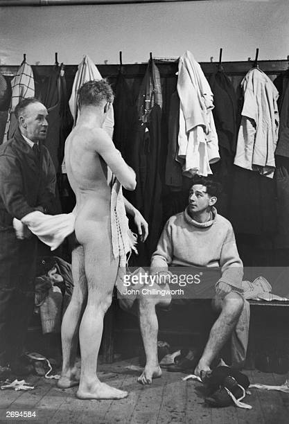 Manchester City trainer Laurie Barnett in the team's dressing room with players W Walsh and S W Evans Original Publication Picture Post 5212 Fighters...