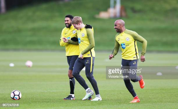 Manchester City Training Barclays Premier League City Football Academy Manchester City's Gael Clichy jokes with Kevin De Bruyne and Fabian Delph...