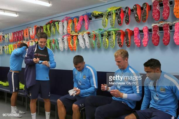 Manchester City Training Carrington Training Ground Manchester City's Samir Nasri Aleksandar Kolarov Joe Hart and Gael Clichy in the changing room at...