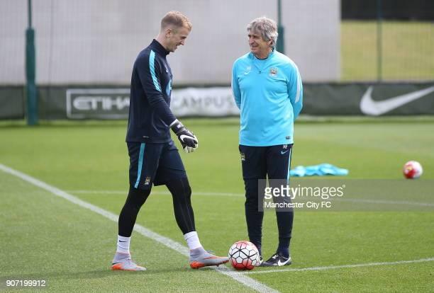 Manchester City Training City Football Academy Manchester City goalkeeper Joe Hart and Manchester City manager Manuel Pellegrini