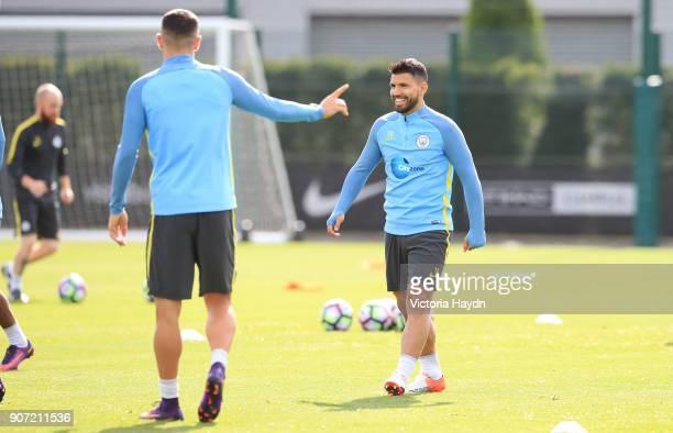 Manchester City Training City Football Academy Manchester City's Aleks Kolarov jokes with Sergio Aguero