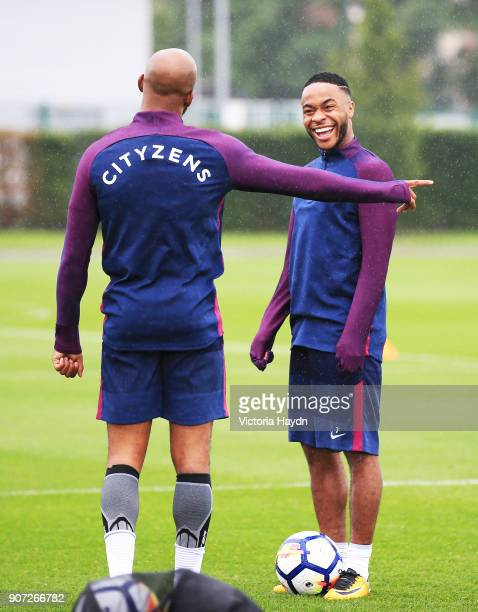 Manchester City Training City Football Academy Manchester City's Fabian Delph and Raheem Sterling during training