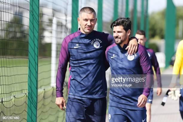 Manchester City Training City Football Academy Manchester City's Aleksandar Kolarov and Nolito walking to training