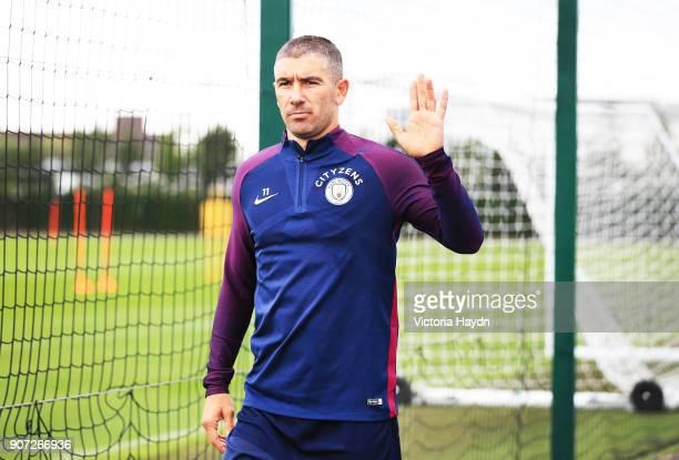 Manchester City Training City Football Academy Manchester City's Aleksandar Kolarov waves at the camera on the way to training
