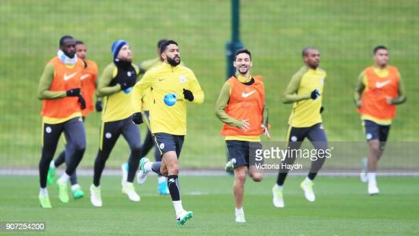 Manchester City Training City Football Academy Manchester City's Gael Clichy leads the warm up