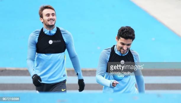 Manchester City Training City Football Academy Manchester City's Jesus Navas and Aleix Garcia walk to training