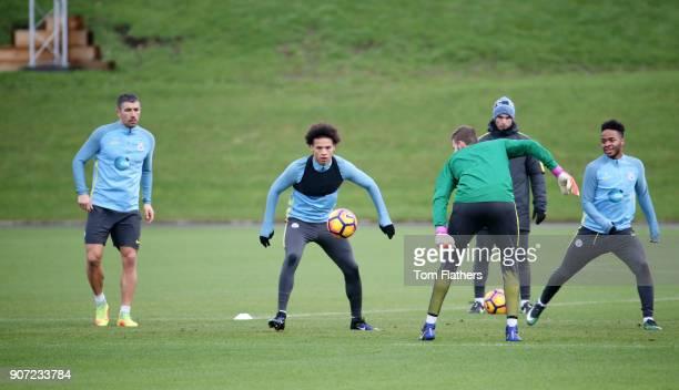 Manchester City Training City Football Academy Manchester City's Aleksandar Kolarov Leroy Sane goalkeeper Angus Gunn and Raheem Sterling in training