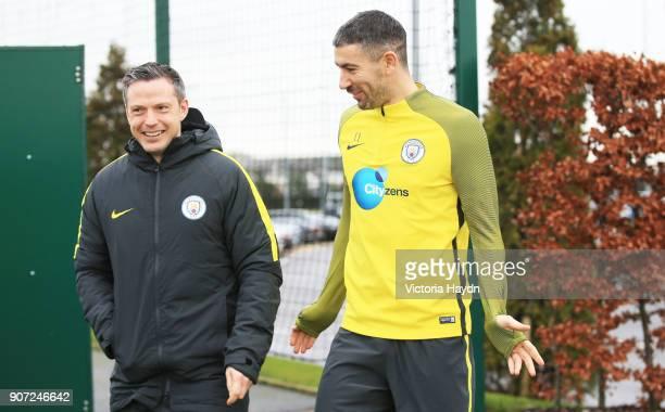 Manchester City Training City Football Academy Manchester City's Aleksandar Kolarov with coach Sam Erith