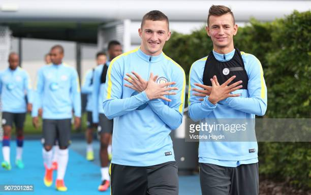 Manchester City Training Session City Football Academy Manchester City's Sinan Bytyqi and Bersant Celina walk to training
