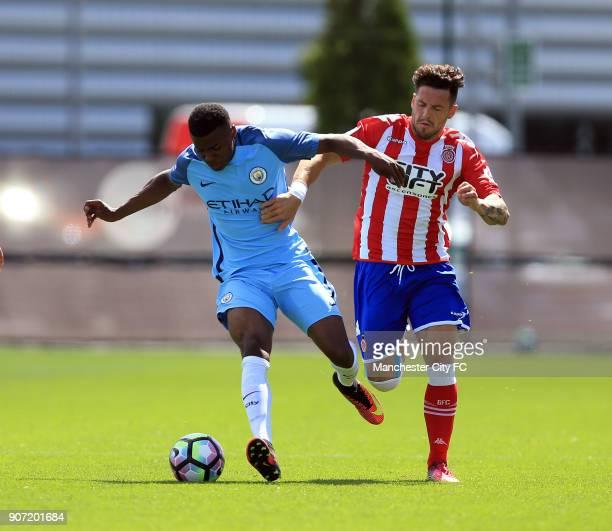 Manchester City U19 v Girona Pre Season Friendly City Football Academy Manchester City's Javairo Dilrosun and Girona's Aday battle for the ball