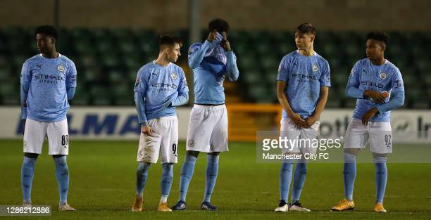 Manchester City U21 look on, after losing on penalties during the EFL Trophy match between Lincoln City and Manchester City U21 at Sincil Bank...