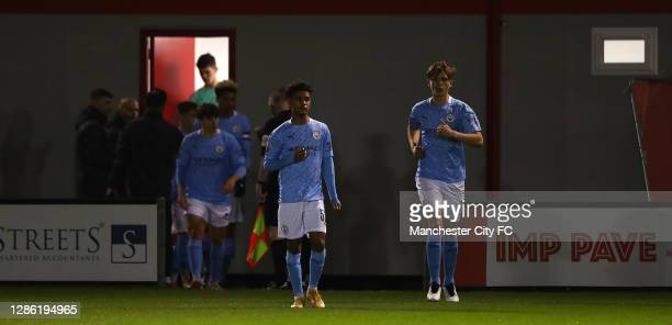 Manchester City U21 players walk out ahead of the EFL Trophy match between Lincoln City and Manchester City U21 at Sincil Bank Stadium on November...