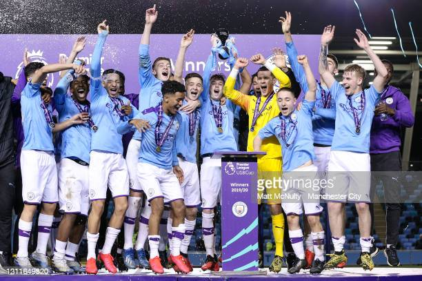 Manchester City Under 18's celebrate lifting the trophy after winning the Premier League Cup during the Under 18's Premier League 2 Cup Final at The...