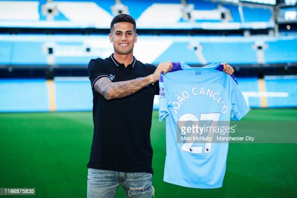 Manchester City unveil new signing Joao Cancelo at the Etihad Stadium on August 08, 2019 in Manchester, England.