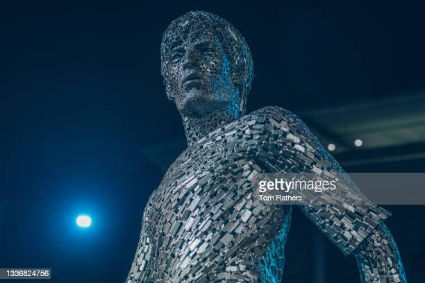 Manchester City unveil statue of David Silva at Etihad Stadium on August 28, 2021 in Manchester, England.