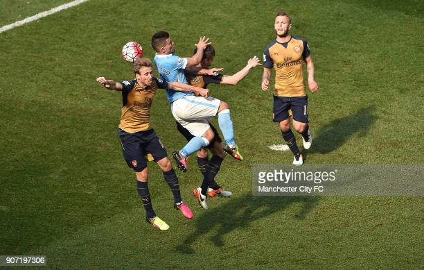 Manchester City v Arsenal Barclays Premier League Etihad Stadium Manchester City forward Sergio Aguero is challenged by Arsenal defender Laurent...