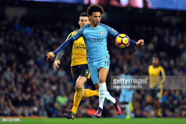 Manchester City v Arsenal Premier League Etihad Stadium Manchester City's Leroy Sane runs past Arsenal's Laurent Koscielny to equalize during the...