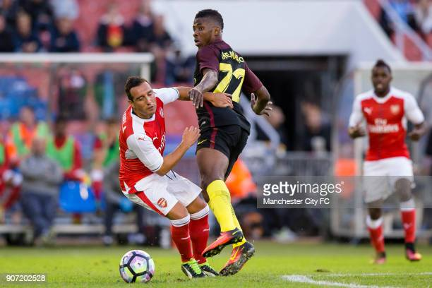 Manchester City v Arsenal PreSeason Friendly Ullevi Stadium Manchester City's Kelechi Iheanacho and Arsenal's Santi Cazorla battle for the ball