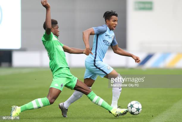 Manchester City v Borussia Monchengladbach UEFA Youth League Group C Manchester City Academy Stadium Manchester City's Demeaco Duhaney battles for...