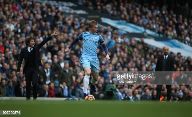 Manchester City v Chelsea Premier League Etihad Stadium Manchester City's Kevin De Bruyne in action as Pep Guardiola and Antonio Conte look on