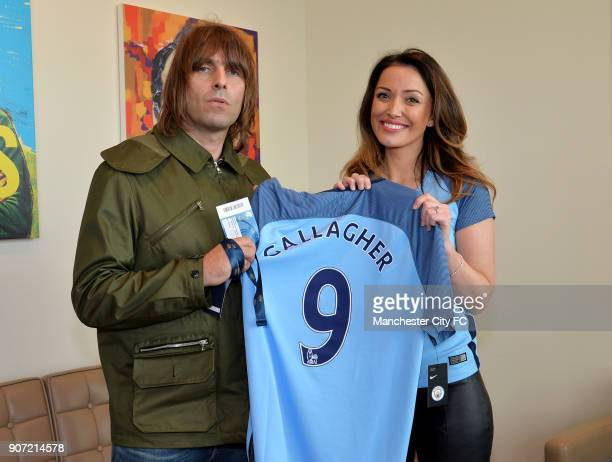Manchester City v Everton Premier League Etihad Stadium Liam Gallagher and Natalie Pike hold a Manchester City shirt emblazoned with 'Gallagher'