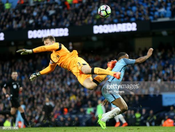 Manchester City v Liverpool Premier League Etihad Stadium Manchester City's Raheem Sterling has his shot blocked by Liverpool goalkeeper Simon...