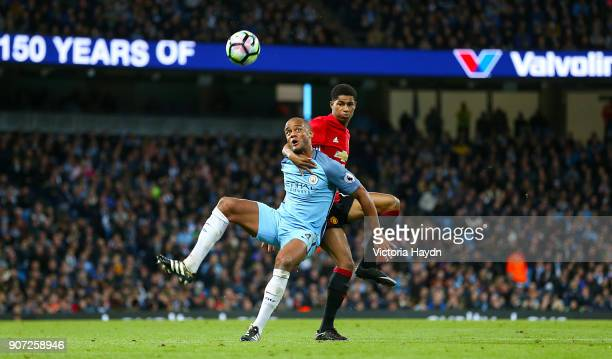 Manchester City v Manchester United Premier League Etihad Stadium Manchester City's Vincent Kompany and Manchester United's Marcus Rashford battle...