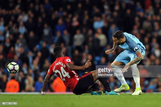 Manchester City v Manchester United Premier League Etihad Stadium Manchester City's Nicolas Otamendi and Manchester United's Timothy FosuMensah in...