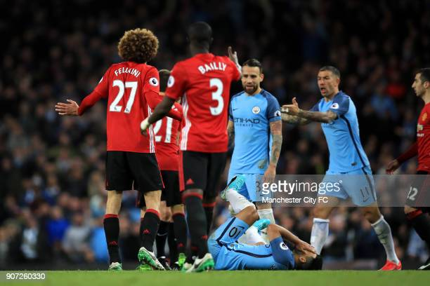 Manchester City v Manchester United Premier League Etihad Stadium Manchester City's Sergio Aguero lies in pain after a challenge by Manchester...